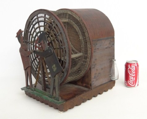 A folk art squirrel cage. (Photo: Copake Auction)