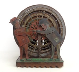 The two articulated figures connected to the exercise wheel. (Copake Auction)